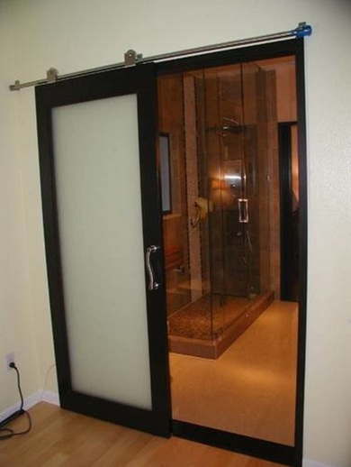 Transparent bathroom sliding glass door with steel barn door Glass bathroom doors interior
