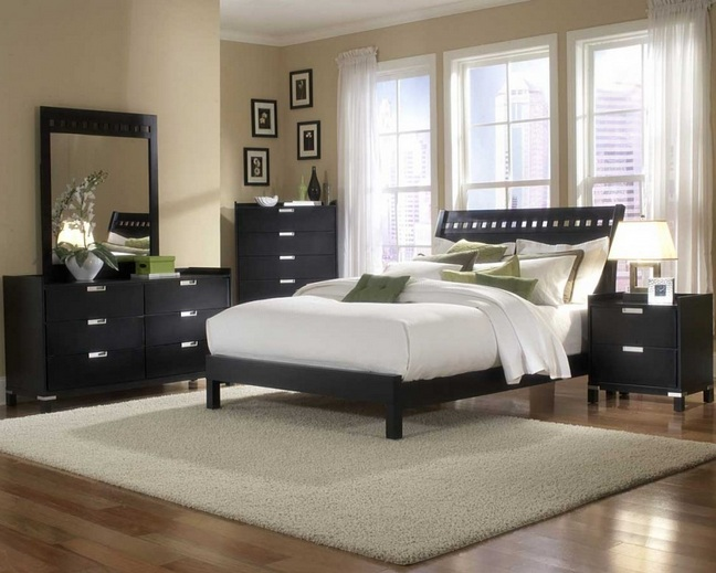 Brown bedroom colors with wooden floor and black furniture ...
