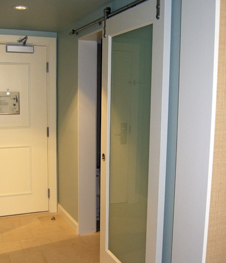 Frosted glass sliding barn door style for bathroom entry for Frosted glass barn door