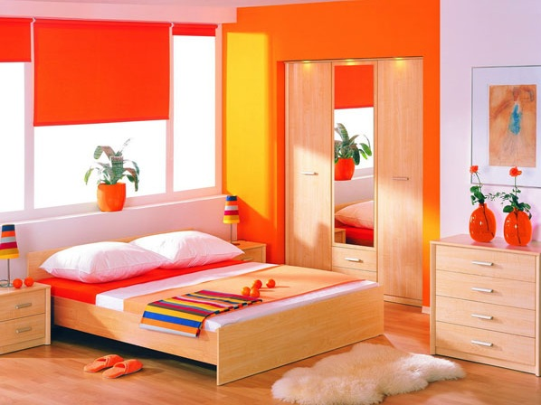Orange bedroom color ideas with light wooden flooring and furniture ...