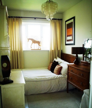 Small Bedroom Decorating Ideas With Soft-Green Bedroom Paint