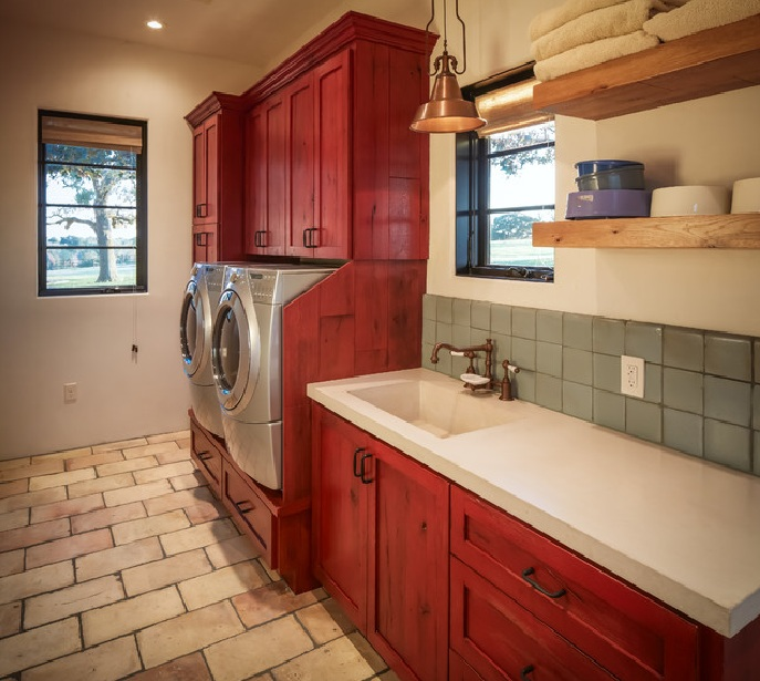 Brick flooring and red painted cabinet for rustic laundry for Floor and decor kitchen cabinets