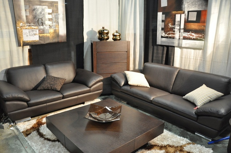 small room with black leather living room set