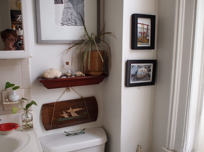 DIY Bathroom Decor With Framed Photo And Vintage Bottles