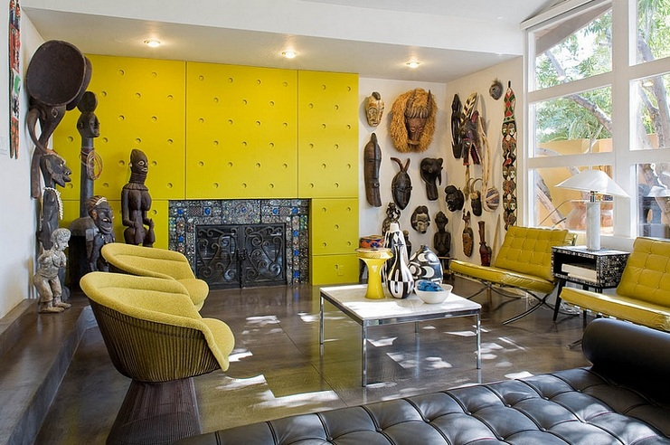 African Themed Living Room With Yellow Wall Panel And Chairs
