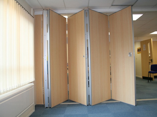 Floor to ceiling room dividers with movable folding doors