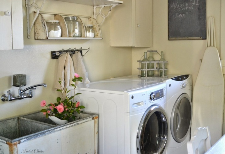 Vintage laundry room decor with vintage utility laundry sink and