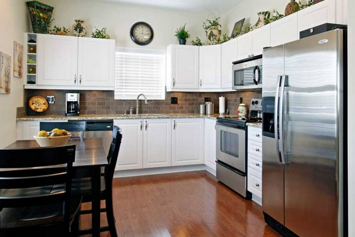 Greenery above kitchen cabinets ideas in l shaped kitchen for L shaped bedroom cupboards