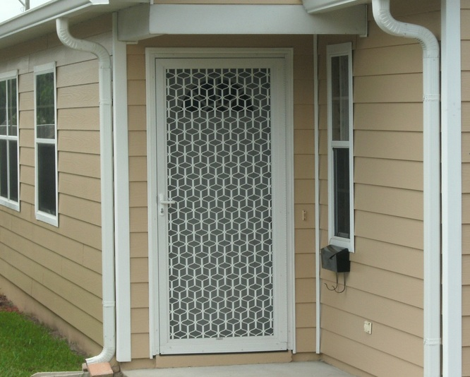 Decorative security screen doors by colonial casting for Decorative screen doors